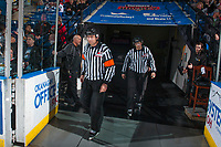 KELOWNA, CANADA - APRIL 14: Referee Reagan Vetter and linesman Dustin Minty enter the ice at the Kelowna Rockets against the Portland Winterhawks on April 14, 2017 at Prospera Place in Kelowna, British Columbia, Canada.  (Photo by Marissa Baecker/Shoot the Breeze)  *** Local Caption ***