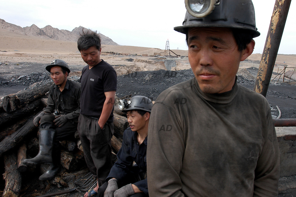 China, the world's biggest coal producer (more than a billion tons of coal a year, accounting for 60 percent of world trade), is beginning to wield its influence as a major coal-exporter to secure a dominant position in the sector and control world prices...China's economic boom has been built on the back of coal. Under the actual conditions in China, coal fired power generation is generally the most practical and economical way of power generation in this country. The 80% of power generated in China comes from coal; nuclear power will account for less than 1% and hydropower less than 20%. It is expected that coal fired power generation has long been and will continue to be the main source of electricity of this country in the past, present and in the next 50 years in the future...The first half of this year has seen successive coalmine accidents. Statistics show that from April 1 to May 16, 62 accidents occurred in coalmines, causing casualties of 503 people. Often the pits may be as much as 260 metres below the surface and their condition is also unknown...These small coalmines, which are usually run by enterprises to gain profit for themselves, have no basic safety guarantee and their management paid less attention to government regulations on safety working and operation...Small coal mines in Wuhai area. Miners ready to go down the mine.