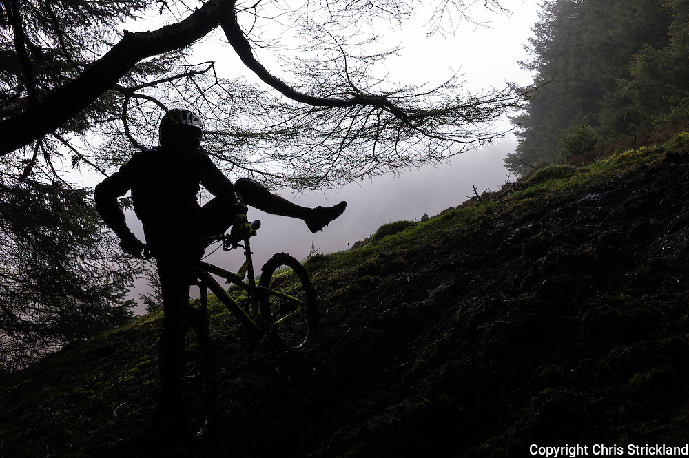 Glentress, Peebles, Scotland, UK. 31st May 2015. The muddy conditions on get the better of Frédéric Rolland on Stage 5 of The Enduro World Series Round 3 taking place on the iconic 7Stanes trails during Tweedlove Festival.