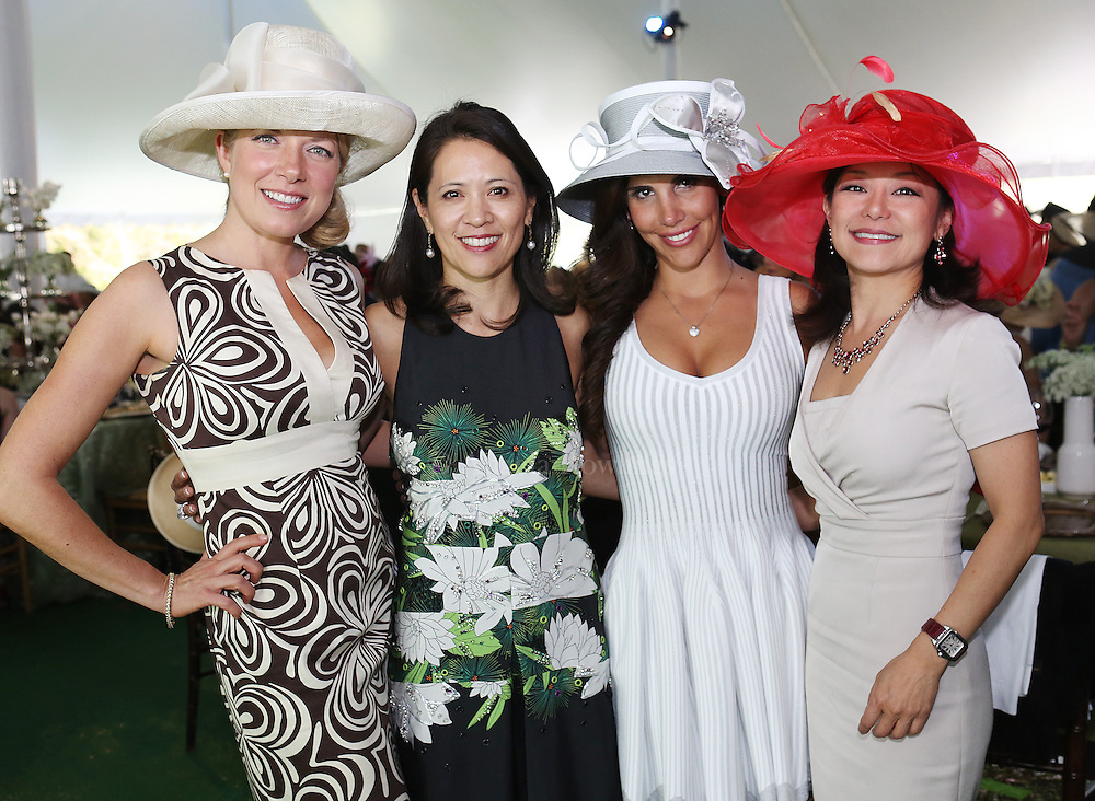 (Boston, MA - 5/15/13) Kelly Boullet, left, Nancy Adams, Adriana Hassan, and Janet Wu attend the Party in the Park at the Kelleher Rose Garden to benefit the Justine Mee Liff Fund, Wednesday, May 15, 2013. Staff photo by Angela Rowlings.