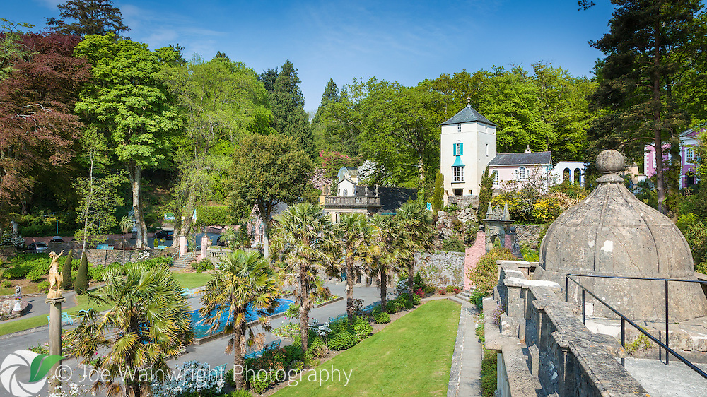 Trachycarpus palms bring an exotic quality to the Central Piazza at Portmeirion, Gwynedd, North Wales - photographed in April.