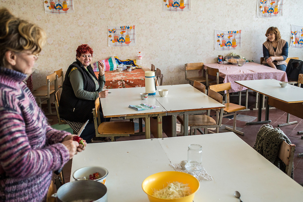 DNIPRODZERZHINSK, UKRAINE - OCTOBER 11: A woman prepares food in what has become the kitchen at an unused portion of a sports school which now houses around 60 people displaced by fighting in Eastern Ukraine on October 11, 2014 in Dniprodzerzhinsk, Ukraine. The United Nations has registered more than 360,000 people who have been forced to leave their homes due to fighting in the East, though the true number is believed to be much higher.(Photo by Brendan Hoffman/Getty Images) *** Local Caption ***