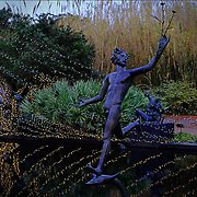 Brookgreen Gardens, in Murrells Inlet, South Carolina, is a sculpture garden and wildlife preserve which includes several themed gardens with American figurative sculptures and trails of nature reserves on the 9,100 acre property.  It was founded by Archer Milton Huntington and his wife Anna Hyatt Huntington to feature sculptures by Anna and her sister Harriet Hyatt along with other American Sculptors.   I was built on a former rice plantation - Brookgreen Plantation.  During the Christmas season many of the sculptures and live oak trees are dressed in brilliant lights.  It is one of the most popular attractions in South Carolina. These are muses playing in a fountain