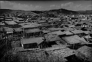 The traditional eastern Tibetan town of Dukezong in 1997, long before the fire which completely destroyed this part of town in January 2014.  Dukezong, Zhongdian (now called, Shangri-La), Yunnan, China.