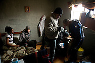 MANENBERG, SOUTH AFRICA - SEPTEMBER 15: Members of the Cape Town Metro Police Gang Unit search a room, where 6 people were sleeping, for drugs and firearms on September 15, 2013 in Manenberg, a township of Cape Town, South Africa. The unit often works before sunrise in the community to execute search warrants and search for wanted criminals. Photo by Ann Hermes/The Christian Science Monitor