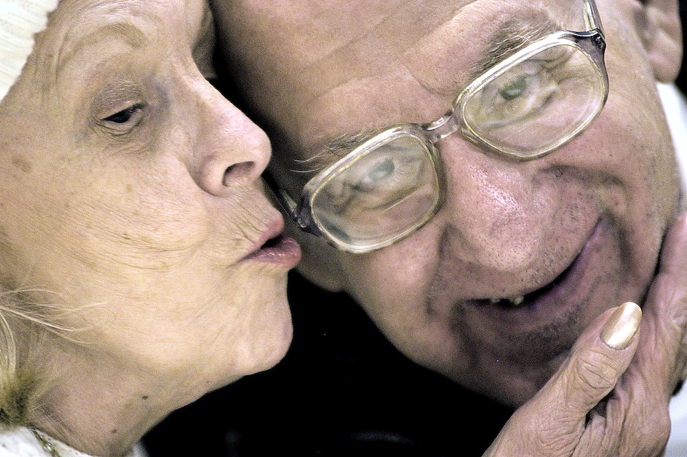 A little sugar after lunch. Lillian Ross takes Eddie Davis by surprise with a friendly peck on the cheek during lunch in the National Gallery cafeteria Friday October 29, 2004.
