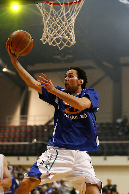 Wellington Saints' guard Troy Mclean warms up before talking on the Hawkes Bay Hawks in the second semi-final of the National Basketball League, TSB Bank Arena, Wellington, New Zealand, Saturday, May 26, 2012. Credit: SNPA/Dean Pemberton.