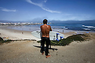 Surfer at Baleal Beach, Peniche, Portugal. PHOTO PAULO CUNHA/4SEE