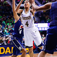 SOUTH BEND, IN - MARCH 04: Skylar Diggins #4 of the Notre Dame Fighting Irish shoots the ball against the Connecticut Huskies at Purcel Pavilion on March 4, 2013 in South Bend, Indiana. Notre Dame defeated Connecticut 96-87 in triple overtime to win the Big East regular season title. (Photo by Michael Hickey/Getty Images) *** Local Caption *** Skylar Diggins
