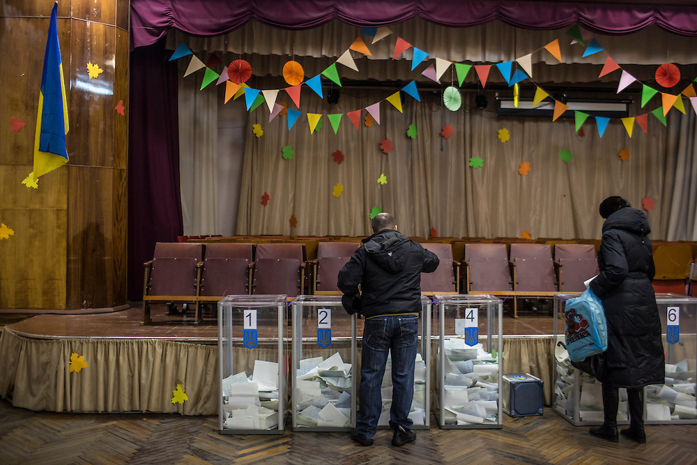 KIEV, UKRAINE - OCTOBER 26: Voters cast their ballots for parliamentary elections at a polling station on October 26, 2014 in Kiev, Ukraine. Although a low turn out is expected in the east of the country, amid continued fighting between Ukrainian forces and pro-Russian seperatists, Ukraine is expected to elect a pro-western parliament in a further move away from Russian influence. (Photo by Brendan Hoffman/Getty Images) *** Local Caption ***
