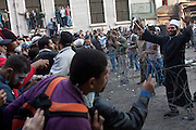 A Muslim cleric tries to keep anit-government protestors from reaching the Interior Ministry as the military took control of the area and the Egyptian police retreated back from the area .  Violence continued  for the fifth day in Cairo , Egypt November 23,2011.  (Photo by Heidi Levine/Sipa Press).