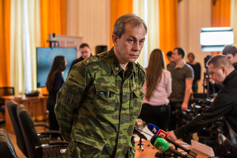 DONETSK, UKRAINE - FEBRUARY 3, 2015: Eduard Basurin, deputy commander of the Donetsk People's Republic, leaves following a news conference in Donetsk, Ukraine. As fighting between Ukrainian and rebel forces remains fierce, rebels today claimed that they downed both a helicopter and an airplane belonging to Ukrainian forces over the past 24 hours. CREDIT: Brendan Hoffman for The New York Times