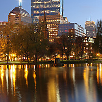 Boston twilight photography showing cityscape landmarks such as John Hancock building, Prudential Center and parts of the Public Garden captured on a magical spring night in May. <br />