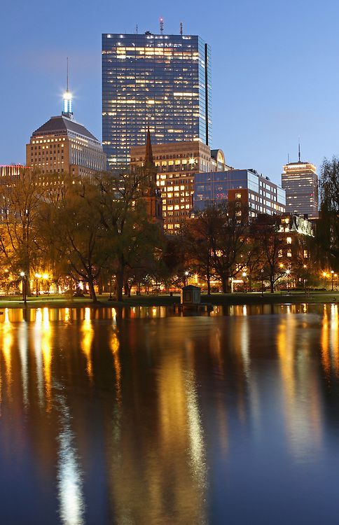 Boston twilight photography showing cityscape landmarks such as John Hancock building, Prudential Center and parts of the Public Garden captured on a magical spring night in May. <br /> <br /> Boston photos are available as museum quality photography prints, canvas prints, acrylic prints or metal prints. Prints may be framed and matted to the individual liking and decorating needs: <br /> <br /> http://juergen-roth.artistwebsites.com/featured/arlington-street-church-juergen-roth.html<br /> <br /> Good light and happy photo making! <br /> <br /> My best, <br /> <br /> Juergen<br /> www.RothGalleries.com <br /> www.ExploringTheLight.com <br /> http://whereintheworldisjuergen.blogspot.com<br /> https://twitter.com/naturefineart<br /> https://www.facebook.com/naturefineart