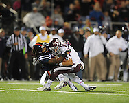 Ole Miss defensive back Charles Sawyer (3) tackled Texas A&M quarterback Johnny Manziel (2) in Oxford, Miss. on Saturday, October 6, 2012. Texas A&M won 30-27...