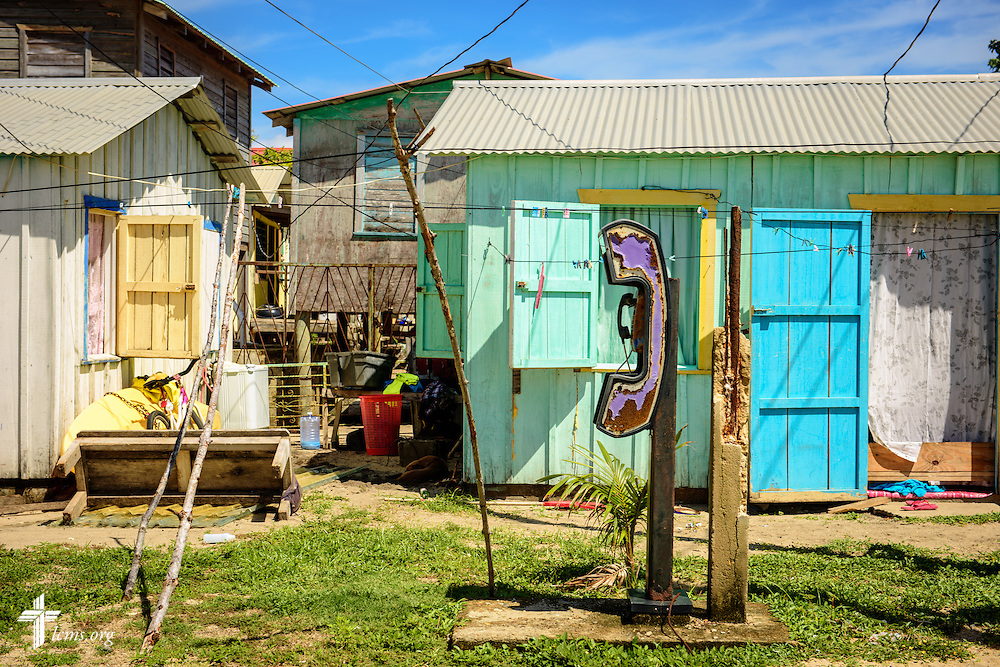 A pay phone is framed by homes on Tuesday, Sept. 27, 2016, in Seine Bight, Belize. Meissner's objective is to plant the first Lutheran churches in the country. LCMS Communications/Erik M. Lunsford