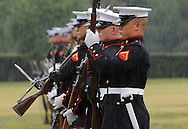 The United States Marines Corps Silent Drill Platoon perform in the rain at the U.S. Marine Corps War Memorial in Arlington, VA on Saturday, September 21, 2013.