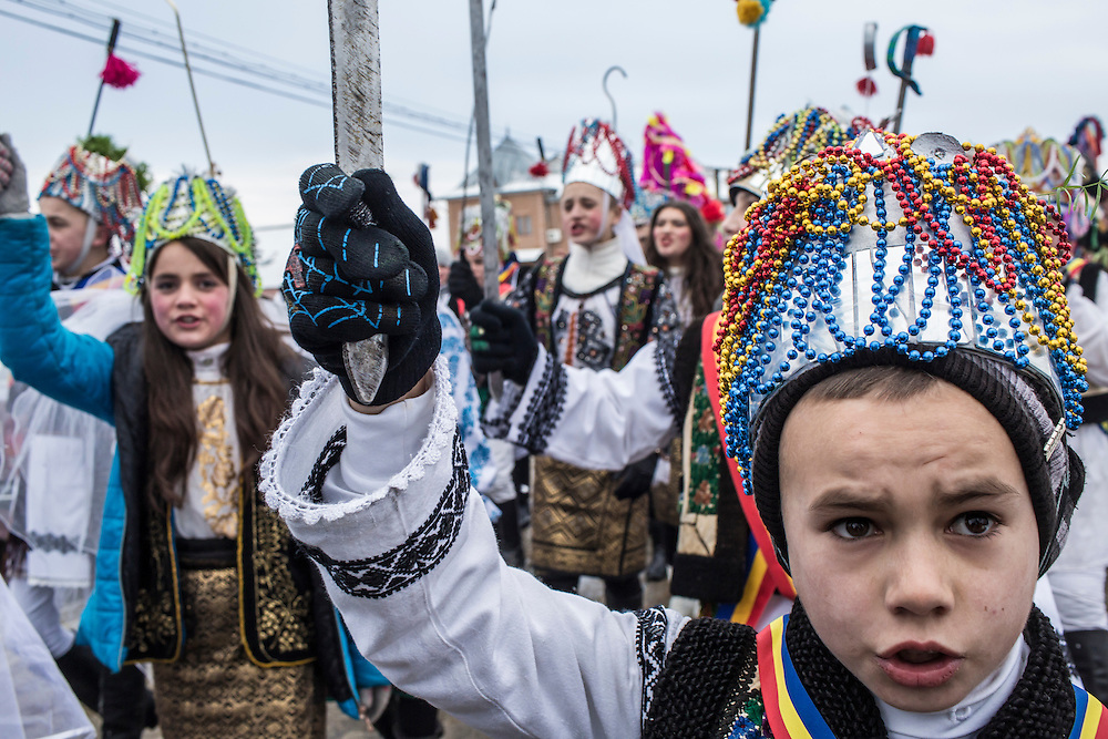 Revelers in tsar costumes celebrate the Malanka Festival on Thursday, January 14, 2016 in Krasnoilsk, Ukraine. The annual celebrations, which consist of costumed villagers going in a group from house to house singing, playing music, and performing skits, began the previous sundown, went all night, and will last until evening.