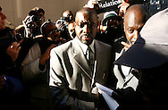 Police brutality victim Abner Louima participates in a  silent march down Fifth Avenue  ''to shop for justice,'' in the police shooting incident that killed Sean Bell and wounded two of his friends on his wedding day in New York, December 16, 2006. .Photo by Keith Bedford<br />