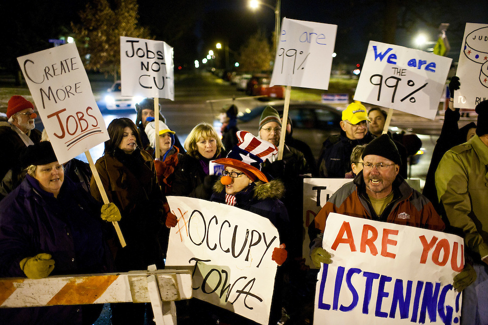 Occupy movement protesters demonstrate outside the site of the Republican presidential debate at Drake University on Saturday, December 10, 2011 in Des Moines, IA.
