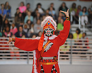 Qiu ping Wang performs with the Beijing Dragon Show Culture & Arts Exchange Co. at Lafayette High School in Oxford, Miss., on Monday, April 1, 2013.