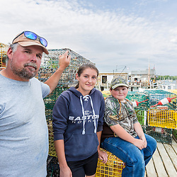 7th generation fisherman Jim Wotton, president of the Friendship Lobster Co-op in Friendship, Maine, with his daugher Emily (17) and son Myron (10). Emily currently fishes 125 traps, and Myron fishes 15 traps.