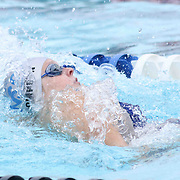 Swimmer Reese Thompson (11) competes in the 50 meter backstroke during the Summer Swim league championships finials Saturday, July. 17, 2015 at Western YMCA in Wilmington, DEL
