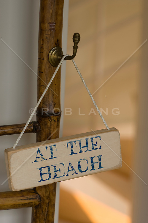 At The Beach sign on a door handle