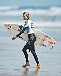 HUNTINGTON BEACH, California/USA (Sunday, August 1, 2010) - Alana Blanchard  walks off the water after finishing third at the US Open of Surfing Junior Pro 2010 Junior Pro Semifinals Heat 1.