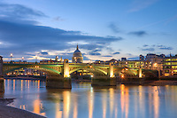 St Paul's cathedral and southwark bridge on the river thames at night in london england by christopher holt