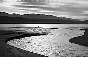 A family explores the ever-shifting delta at the mouth of the Elwha River where it empties into the Strait of Juan de Fuca.