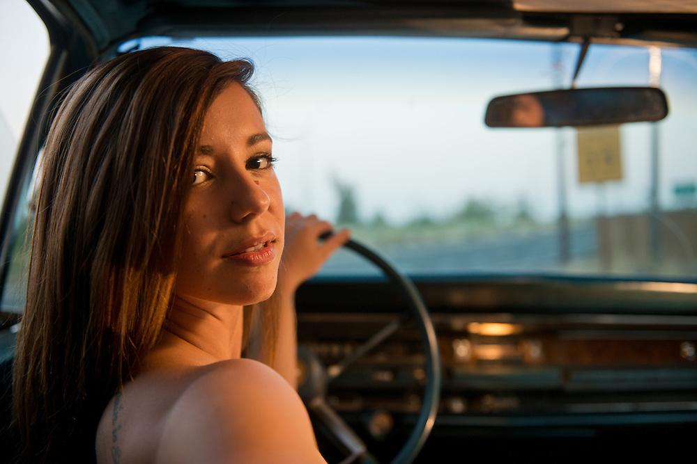 Girl in Limo behind steering wheel, Parkway, Deschutes County, Bend, Oregon,USA, Model Release 0284