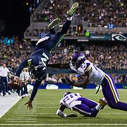 Seattle Seahawks quarterback Trevor Boykin #2 leaps over Minnesota Vikings safety Jayron Kearse #27 during the NFL preseason week 2 game on Thursday, Aug. 18, 2016 in Seattle. The Vikings won, 18-11. (Ric Tapia via AP)