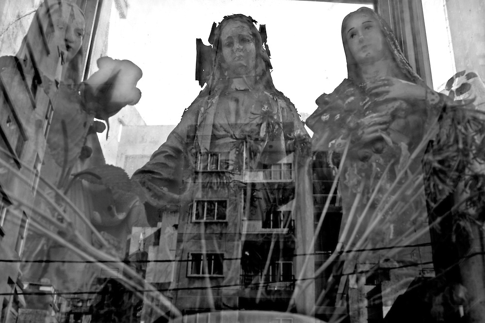 BEIRUT, Lebanon: Apartment buildings in the Christian neighborhood of Ayn-Ar Rummeneh are reflected in the window of a shrine to the Virgin Mary, just metres from the spot where many locals claim civil war first broke out on April 13, 1975.