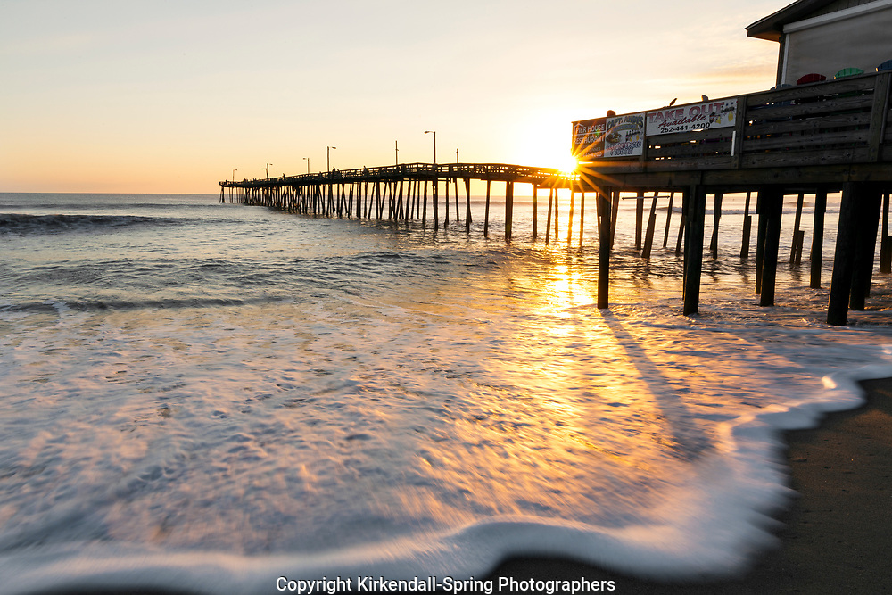 NC00777-00...NORTH CAROLINA - Sunrise at the Nags Head Pier on the Outer Banks.