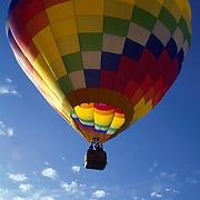 A hot air balloon takes flight.