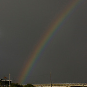 A rainbow forms over a marina in Cedar Key, Florida following the arrival of Tropical Storm Alberto June13, 2006. REUTERS/Scott Audette