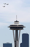 On the 70th anniversary of D-Day three P-51 Mustangs fly in formation past the Space Needle, Fri. June 6, 2014, over Seattle. The lead plane, at right, flown by John Sessions, is a restored P-51B which flew in the invasion. (Ken Lambert / The Seattle Times)