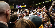 SHOT 2/26/11 5:19:22 PM - Colorado's Alec Burks (#10) high fives fans that had rushed the floor after upsetting Texas during their regular season Big 12 basketball game at the Coors Events Center in Boulder, Co. Colorado upset the fifth ranked Texas 91-89. Burks scored 33 points in the win. (Photo by Marc Piscotty / © 2011)
