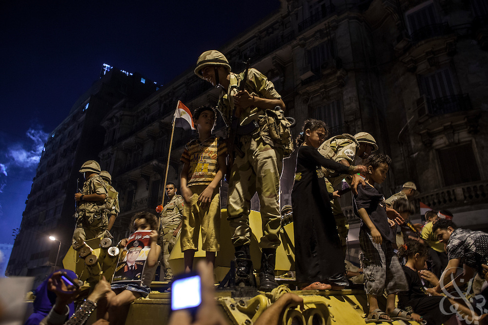 "Children have their photos taken with Egyptian soldiers atop their APC's as people march in mass demonstrations called for by Gen. Abdel Fattah El Sissi , the head of Egypt's military, in the Tahrir Square area of downtown Cairo Egypt on Friday July 26, 2013. EL Sissi had asked Egyptians to take to the streets on Friday to show the world that he had a mandate to deal with ""violence and terrorism""."