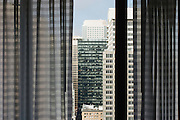 A peek thru the curtains to see a view of downtown San Francisco.