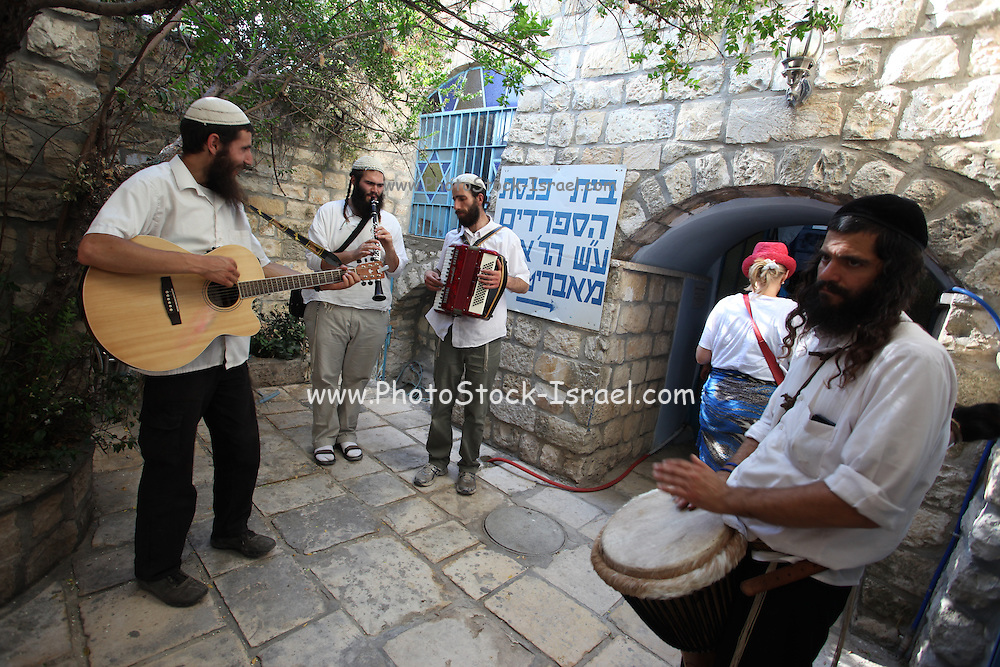 Klezmer (traditional Jewish musicians) play music in a street in Safed