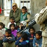 7 December 2004..Jawan, Iraq..US Marines raid suspected insurgent homes.....US Marines based in Yusufiyah, Iraq continued on 7 December ongoing raids against suspected insurgents within the untis area of operation...The Marines have made repeated visits to the family homes of known insurgents thought to have been involved in the recent fighting in Falluja..