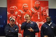 Ole Miss assistant coach Keith Burns (center) and defensive coordinator Tyrone Nix attend head coach Houston Nutt's news conference Monday, Nov. 7, 2011 at the University of Mississippi in Oxford, Miss. Nutt will resign at the end of the season.