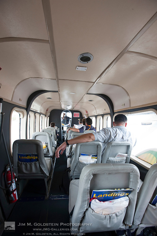 Interior view of a Costa Rican commuter plane with passengers seated for their flight