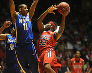 "Mississippi's Zach Graham (32) vs. Memphis's Wesley Witherspoon (11) in NIT second round basketball action at the C.M. ""Tad"" Smith Coliseum in Oxford, Miss. on Friday, March 19, 2010. Ole Miss won 90-81."
