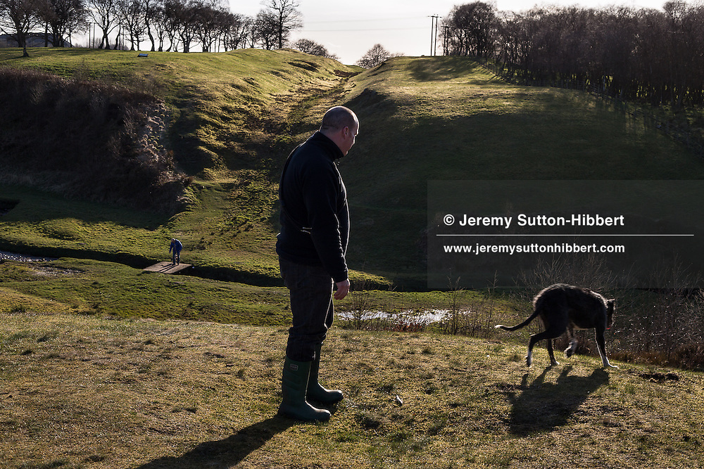 Sean McCabe, of Bonnybridge, and his dogs at the Antonine Wall ditch, near Rough Castle Roman fort, near Falkirk, Scotland, on Friday 19th April 2013. .N55°59.888'.W3°51.433'