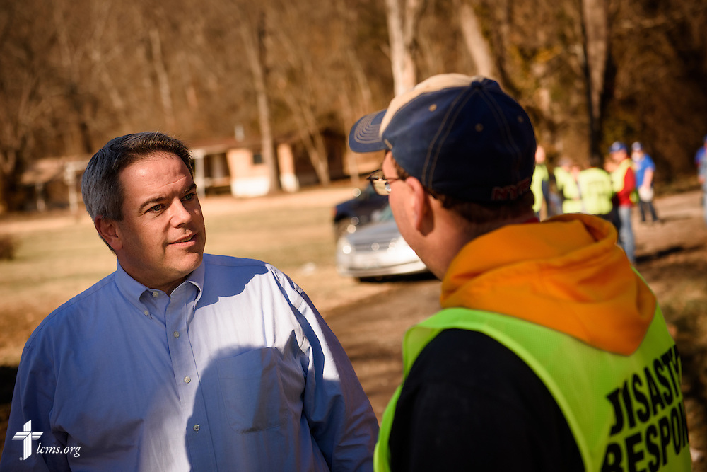 The Rev. Dr. Lee Hagan, district president of the LCMS Missouri District, talks with the Rev. Bart Day, executive director in the LCMS Office of National Mission, following a cleaning event at a flood-damaged home in Fenton on Thursday, Jan. 14, 2016. LCMS Communications/Erik M. Lunsford
