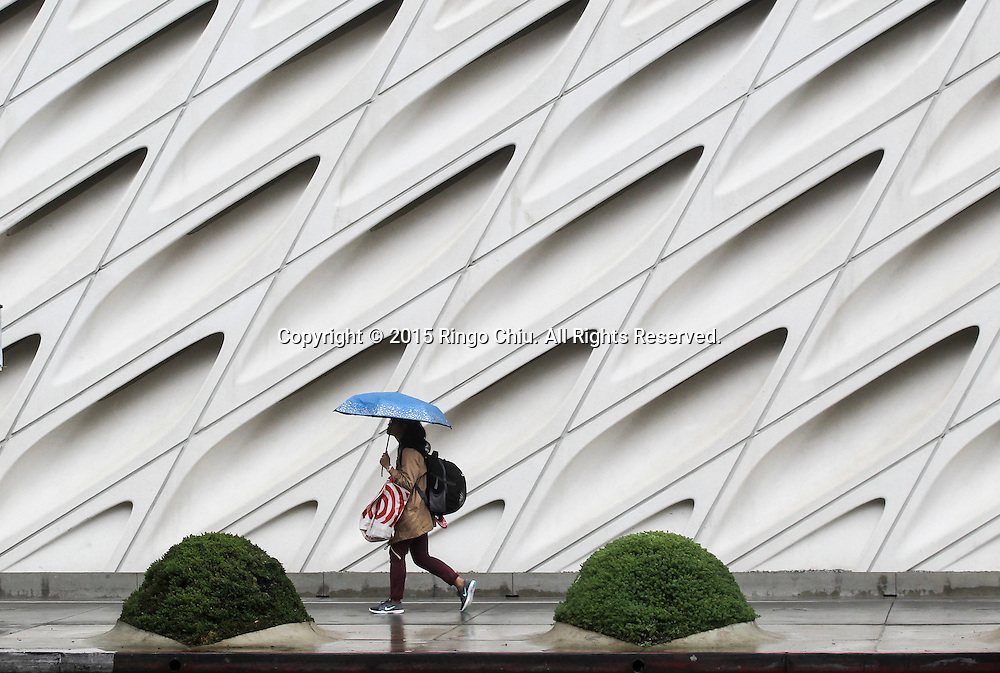 A pedestrian carries an umbrella as she walks along a street in Los Angeles, Tuesday, Dec. 22, 2015. The rain forecast in the Southland this week is the product of a series of storms forecast to cross California as a result of ``a moist northern flow pattern across the region,'' with the highest chance of precipitation today expected in the San Gabriel Mountains in Los Angeles and Ventura counties and in an area stretching from Santa Barbara northward, according to the National Weather Service.(Photo by Ringo Chiu/PHOTOFORMULA.com)<br /> <br /> Usage Notes: This content is intended for editorial use only. For other uses, additional clearances may be required.