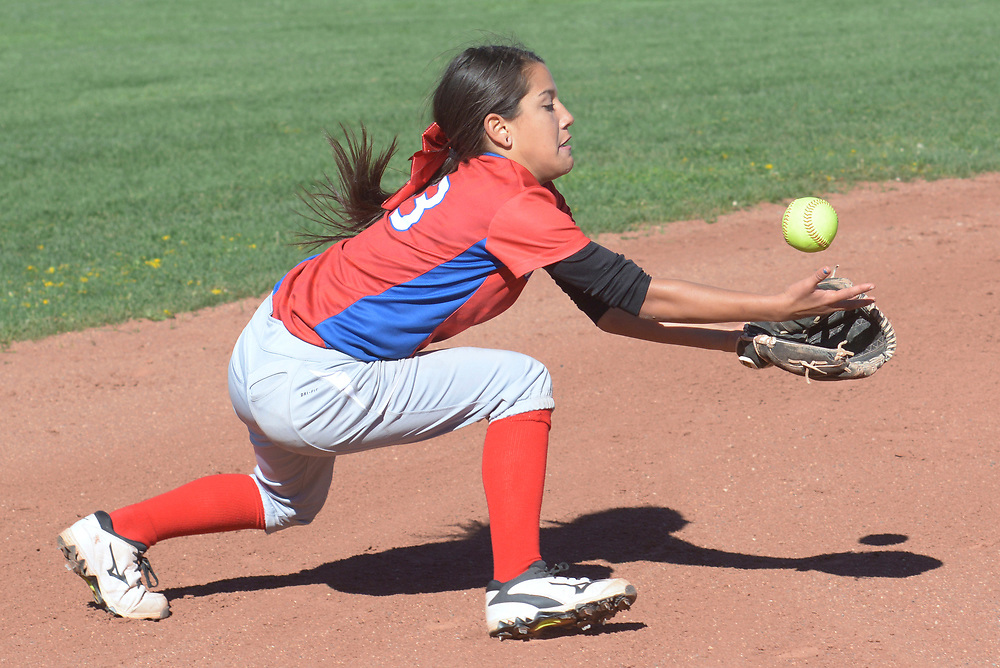 gbs040417c/SPORTS -- West Mesa's Desiree Gurule nobles the ball but finally catches an Aristco Heritage pop up in the second inning of the game at West Mesa on Tuesday, April 4, 2017. (Greg Sorber/Albuquerque Journal)
